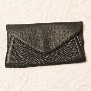 Snakeskin leather clutch